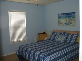 Surf City condo photo - Bedroom with queen size bed and TV - opens to private bathroom