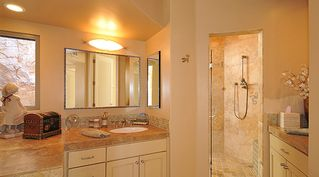 Tucson house photo - Master bath with one of two sinks and walk in shower