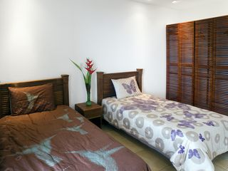 Dominical villa photo - 4th Bedroom w/ two twin beds, SW facing balcony w/ ocean, forest, sunset