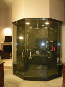 Oversized shower in master bath. It also is a steam room/ shower