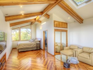 Upstairs bedroom with bathroom, patio and entrance to back yard. - Tiburon house vacation rental photo