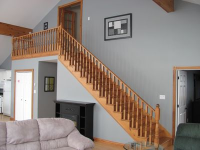 Stairs lead to master bedroom/ensuite on the second level