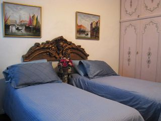 Trastevere area condo photo - The bed can be separated to offer two singles. There is a large clothes wardrobe