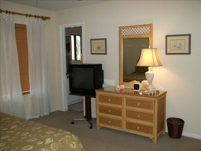 t.v. and dresser area of the large king bedroom.