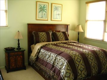 Plush queen bedroom located downstairs with bathro