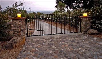 Solvang house rental - Gated property entrance iron security gate with off street parking.