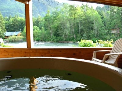 Covered porch includes a hot tub overlooking the Skykomish River and Mt.Index.