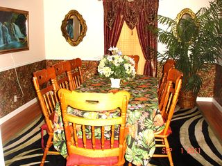 Gulf Shores house photo - Entertain your guest in this lovely dining room that seats 8 comfortably
