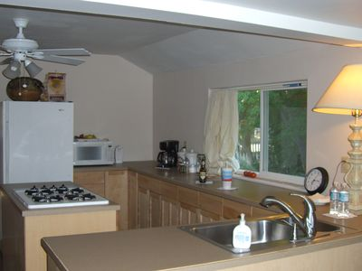 Kitchen has lots of counter space, gas stove, microwave and toaster oven.