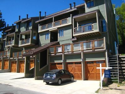 Quittin' Time Condo building front with private garage for each unit