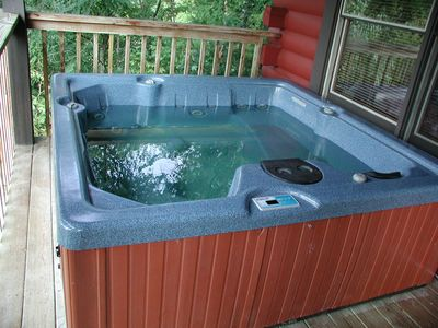 Hot tub located on back deck overlooking the lake!