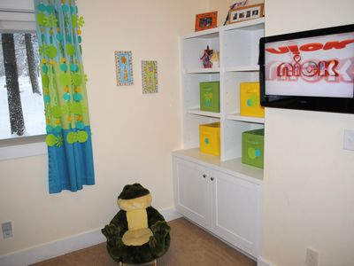 View #2 of Kids' Bunk bed room with flat screen tv and built-in storage.