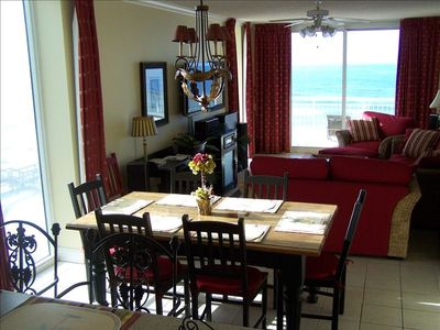Large Dining Table for Family Meals with window and balcony beach views