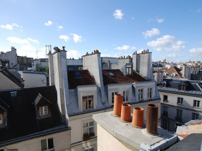 The apartment has sweeping views over the famous rooftops of Paris