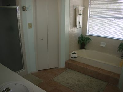 Master bath with double sinks, closet, shower, and garden tub.