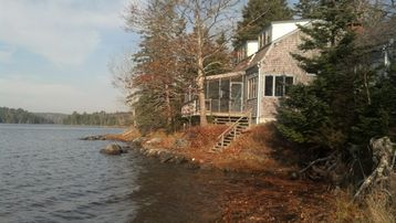 Hancock cottage rental - cottage at high tide, facing southwest