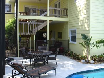 Lanai,covered staircase to 2nd floor, deck and BRs