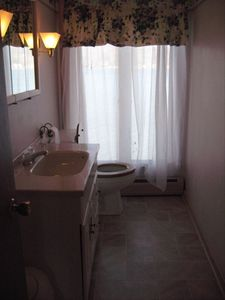 Upstairs half bath, soft colors, nicely appointed, with lake view!