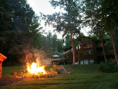 Partial view of garden, fire pit, and lake
