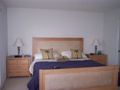 Master Bedroom w/ En Suite Dressing Area and Bath. Private access to Deck