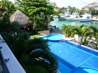 Puerto Aventuras condo rental - View from the terrace. Pool and Marina