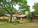 Surrounded by large oaks - Rustic Sprawling 3400 sq ft residence.