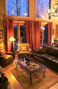 Living Room Faces Large Stacked Stone Wood Burning Fireplace. - Smoky Mountains