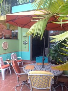 Lovely colorful patio facing marina. Perfect place for grilling & entertaining