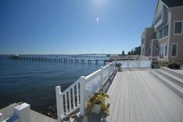 enjoy relaxing on this deck overlooking the open bay watching the boats go by