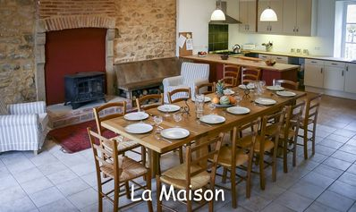 La Maison well equipped kitchen and dining room