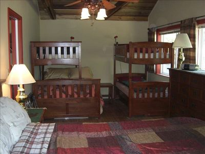 Bedroom with king bed and 2 bunks