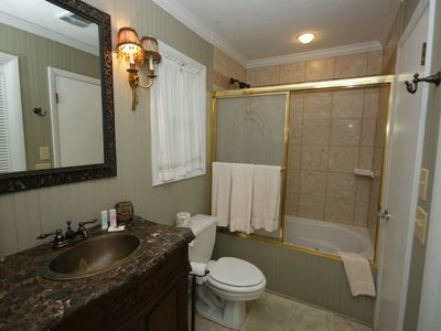 Granite and Marble bath renovated with jacuzzi tub/Adjoins twin rm and hall.