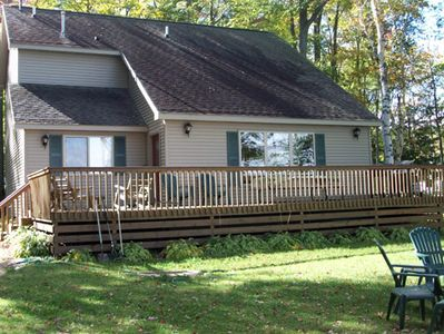 Pellston cottage rental - Lake side view of cottage and deck