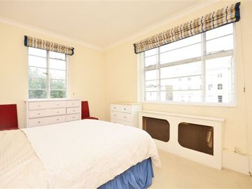 Bedroom has a king sized double bed with build in cupboards