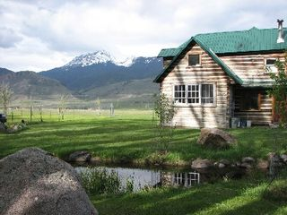 Gardiner cabin photo - Yellowstone Park in front yard. Windows look into the kitchen