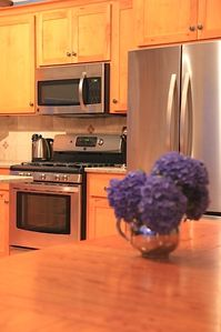 Enjoy the gas range with 5 burners and french door refrigerator.