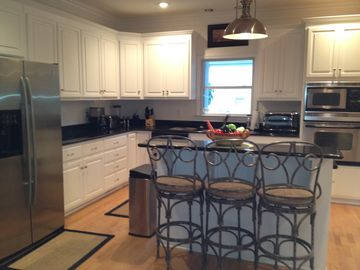Open Kitchen with Granite Countertops, eat in counter, Jenn-Air & GE appliances