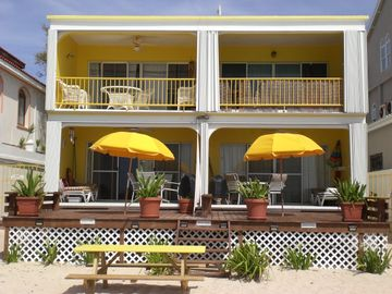 Pix is frm the beach.Condo is ground floor w/yellow umbrella on left side of pix