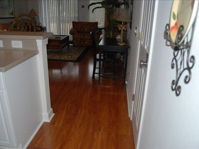 Gorgeous wood floor looking into living room.