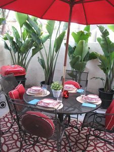 Dine al fresco on our lush patio with gas BBQ