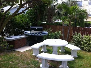 Clearwater Beach condo photo - Gas barbeque grill located next to the pool