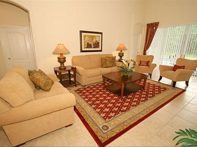 "Living Room with 42"" LCD TV/Cable/DVD with direct access to Pool Lanai area"