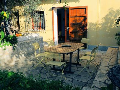 Table outside kitchen in shade of olive tree