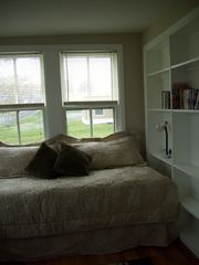 Colonial Beach cottage photo - Third bedroom; nice sunny room with bookshelves; twin bed.