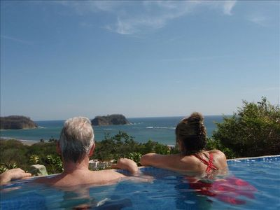 Enjoy a panoramic view from the privacy of your salt-water infinity edge pool.