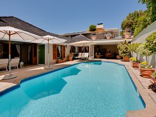 Constantia villa photo - Umbrellas around Heated Pool