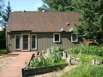 Higgins Lake house rental - Entrance view, road side. Walkway is handicap-friendly.