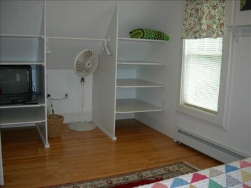 Easy storage of all your clothes in up queen bedroom. Wood floors & water view.