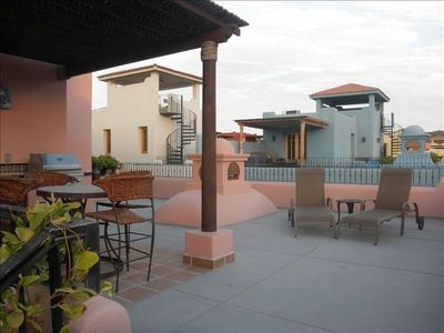 2nd floor terrace with loungers, patio table & chairs, barbecue