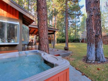 Evergreen Estates house rental - The hot tub is tucked in the corner and among the trees.